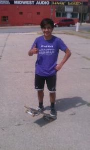 Mateo and his skateboard
